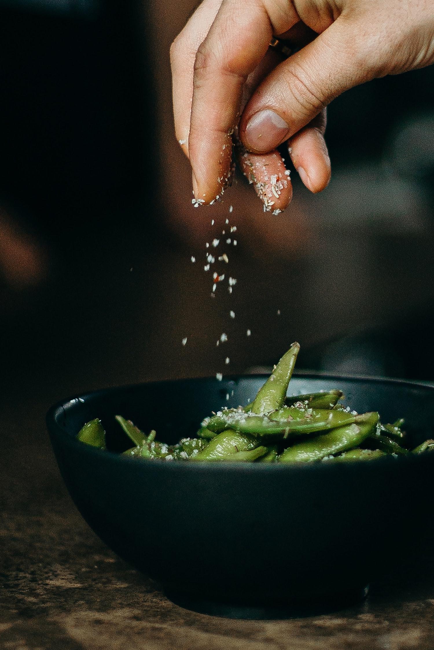 Sprinkle of salt on Green Vegetables