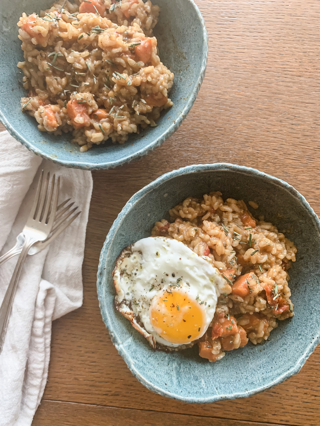 Bowls of Risotto with a Fried Egg