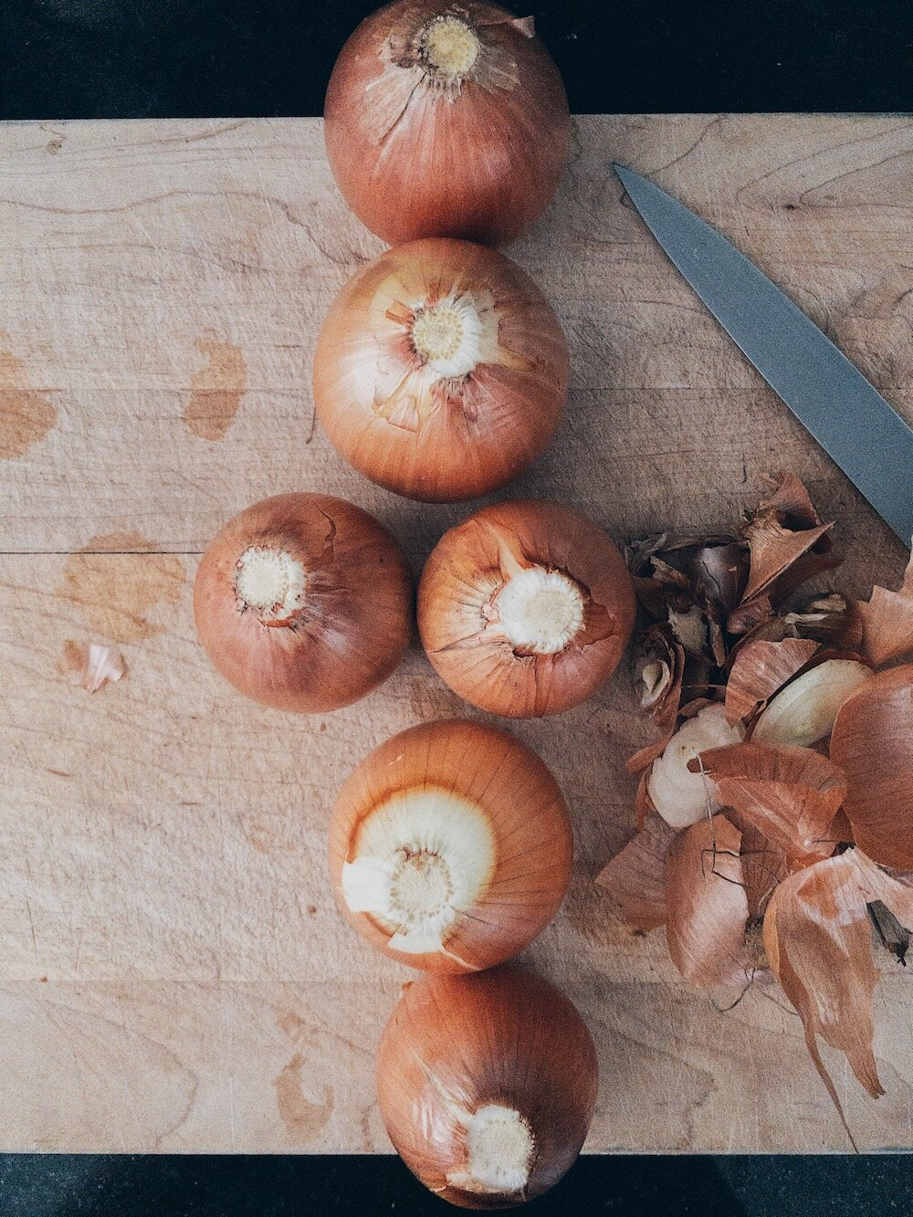 Whole Onions on Cutting Board