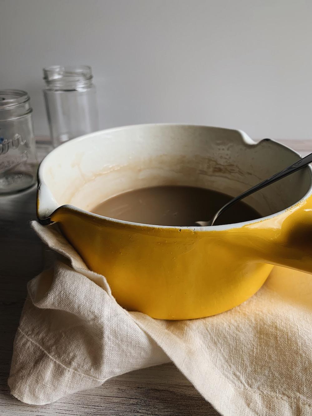 Pot of dairy-free salted caramel sauce