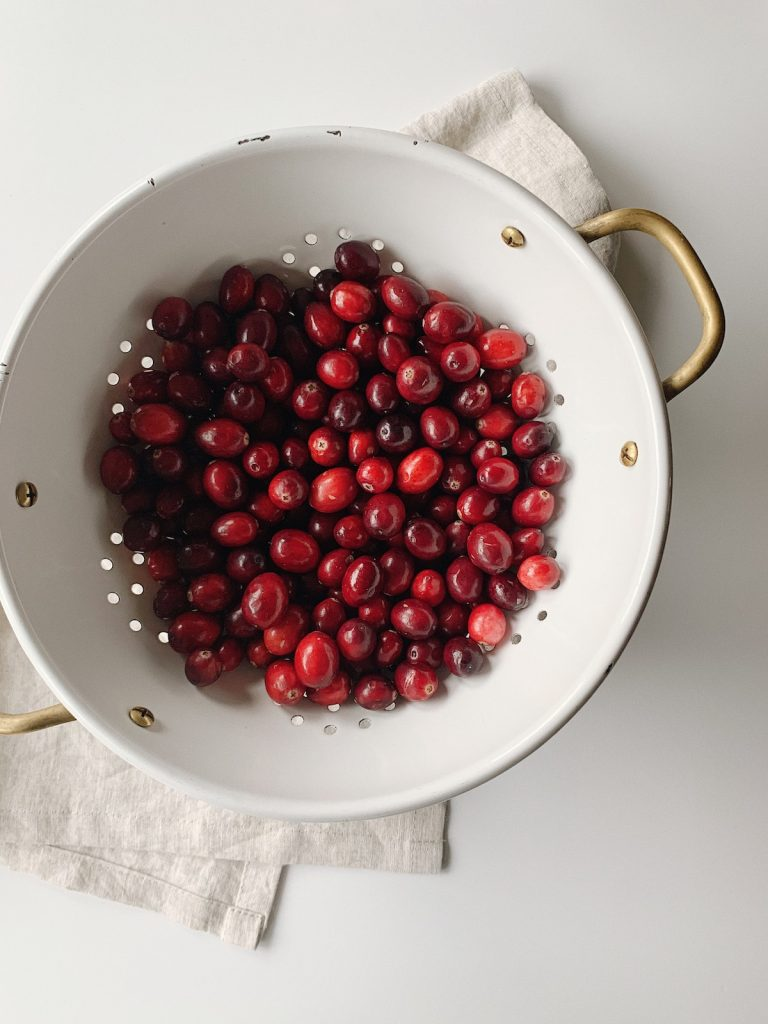 colander full of fresh cranberries