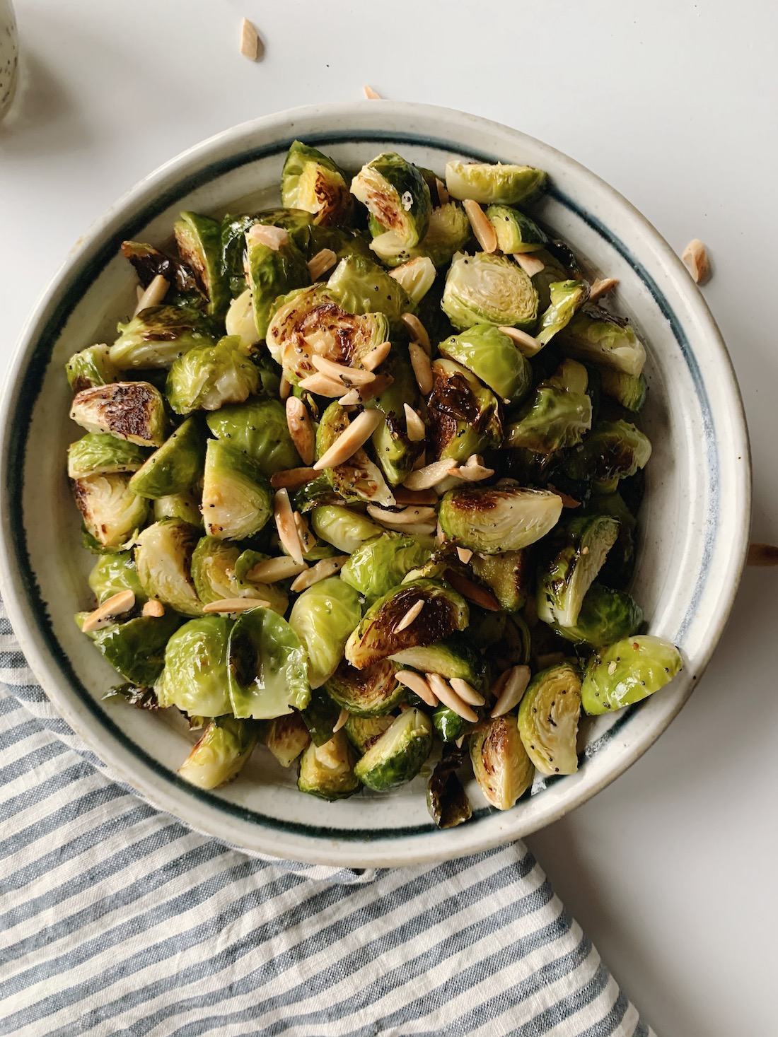 Bowl of roasted Brussels sprouts with almonds