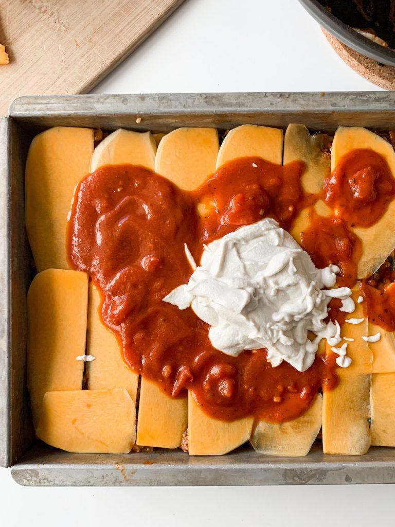 dairy-free ricotta and pasta sauce on veggies