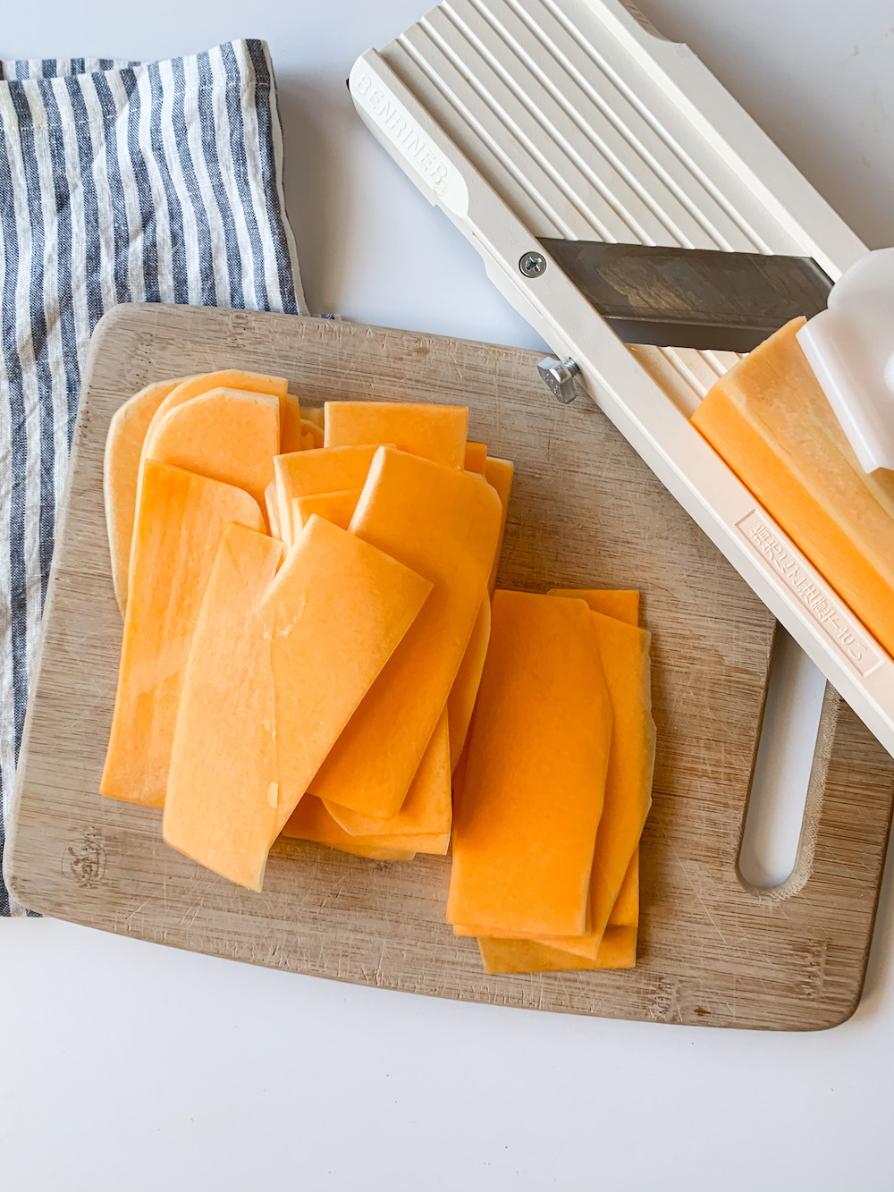 Thinly sliced pile of butternut squash sheets