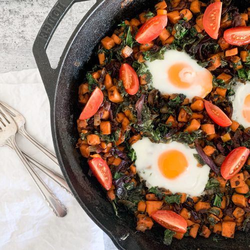 a pan of healthy breakfast hash with forks