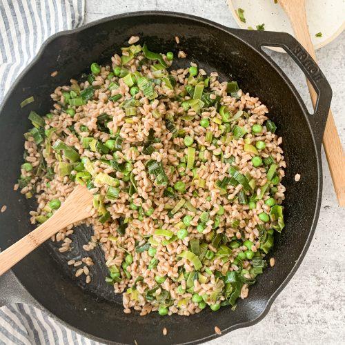 pan of pea and leek greens risotto