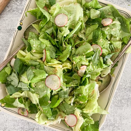 butter lettuce salad on a large serving platter