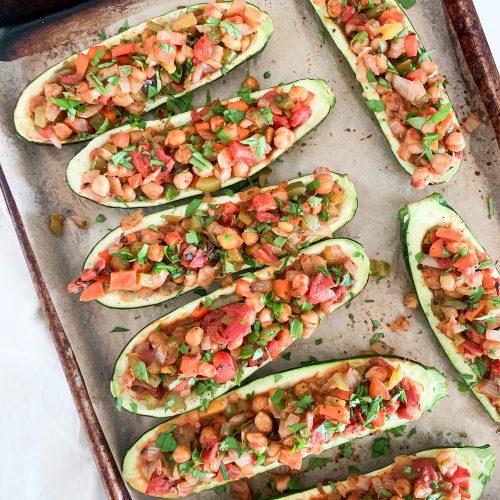 baking tray of stuffed zucchini boats
