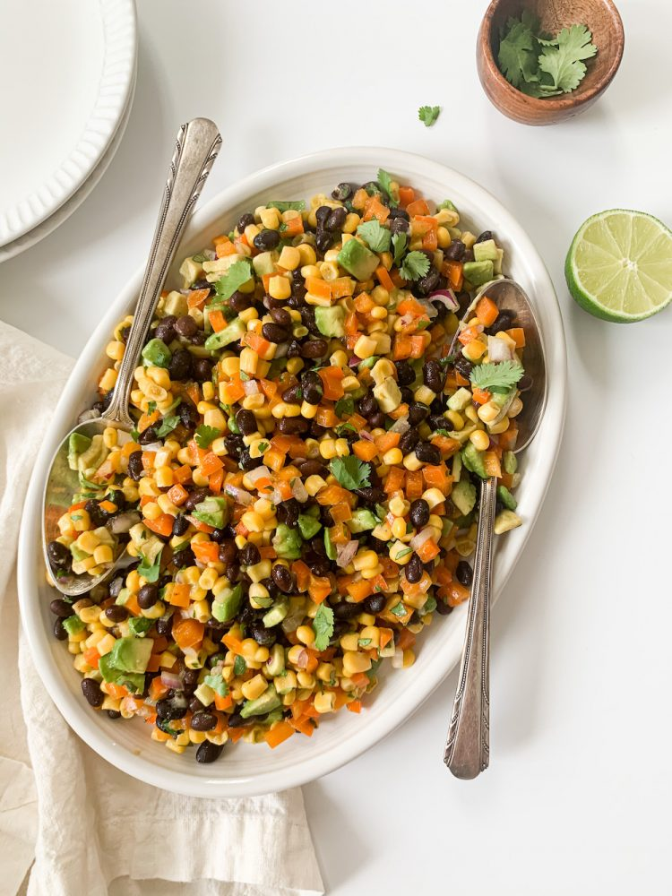 serving dish of black bean and corn salad with fresh lime