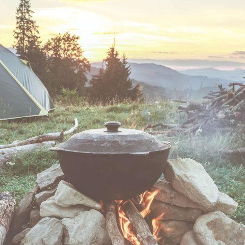cast iron pot over a campfire