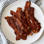a plate of perfectly cooked oven bacon
